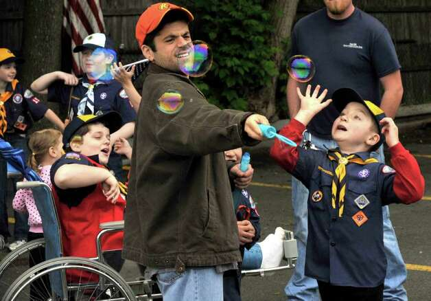 Brandon Beiermann, 7, right, chases bubbles before marching with Cub Scout Pack 54 in Bethel's Memorial Day parade, Sunday, May 22, 2011. Photo: Michael Duffy / The News-Times