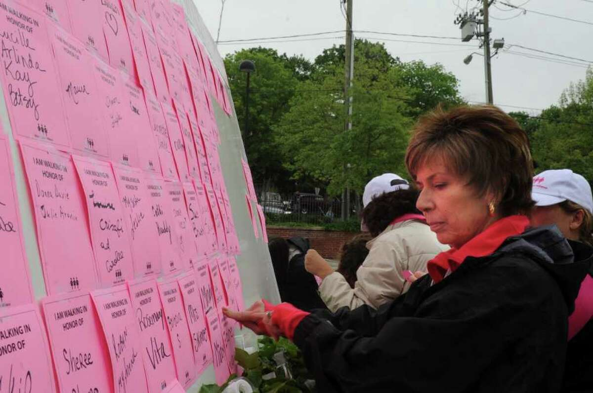 Anna Marie Vlad, of Greenwich, a breast cancer surviver puts a note on the bulletin at the Breast Cancer Alliance sixth annual Hands Across the Avenue on Sunday, May 22, 2011.