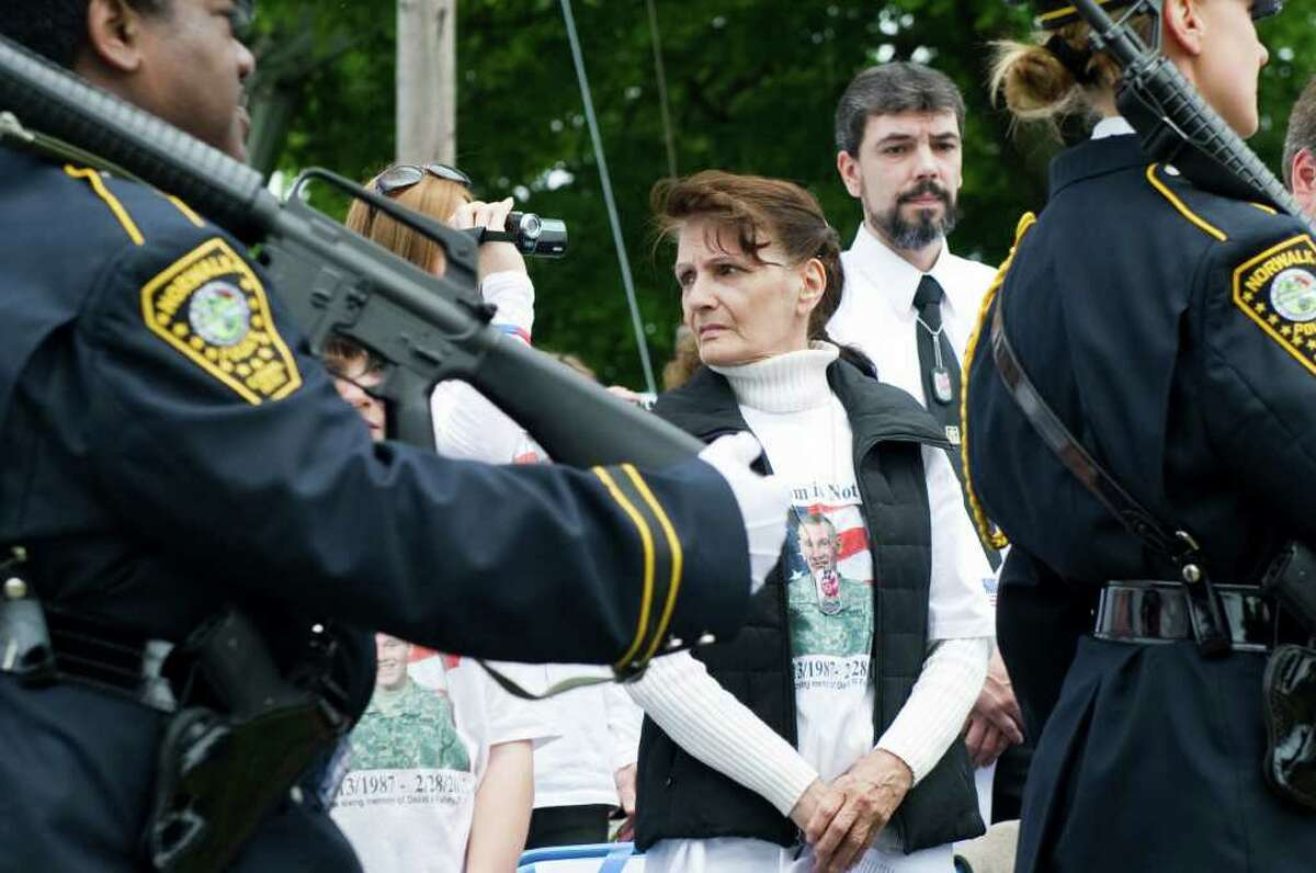 Sharon Trepanier watches as the Norwalk Veterans Committee Ceremony honoring her grandson Spc David Fahey gets underway at the Shea-Magrath Memorial at Calf Pasture Beach Park in Norwalk, Conn., May 22, 2011. Fahey was killed Feb. 28 in Afghanistan, his name will be added to the memorial plaque at the site.