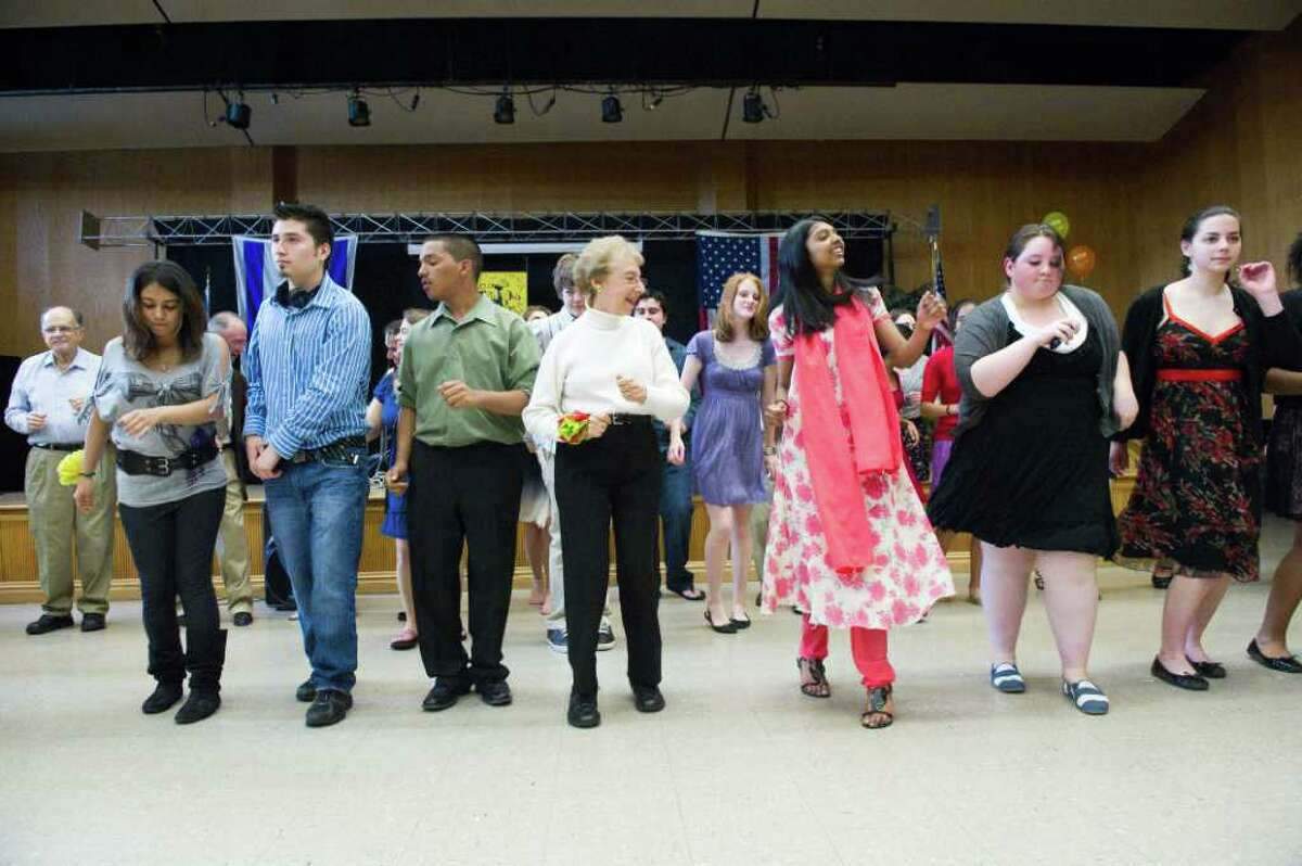"""Daisy Schaeffer, center, cuts a rug with Stamford High School Student group """"Build On"""" as they host a prom for seniors at the Jewish Community Center in Stamford, Conn., May 22, 2011."""