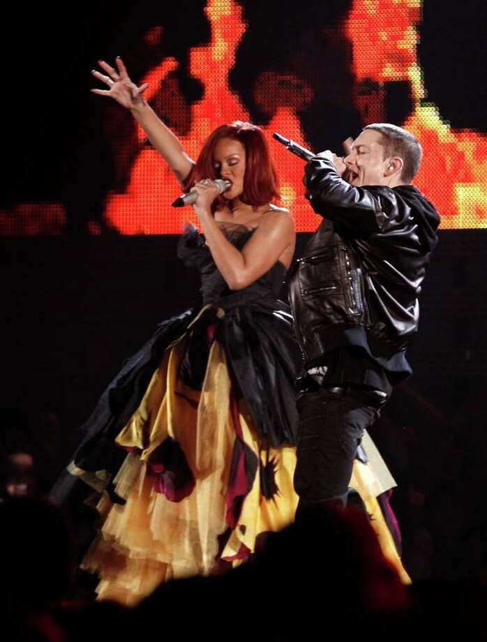 FILE - In this Feb. 13, 2011 file photo, Rihanna, left, and Eminem perform at the 53rd annual Grammy Awards in Los Angeles. Rihanna and Eminem are among the top competitors at the Billboard Music Awards on Sunday May 22.  (AP Photo/Matt Sayles, file) Photo: Matt Sayles