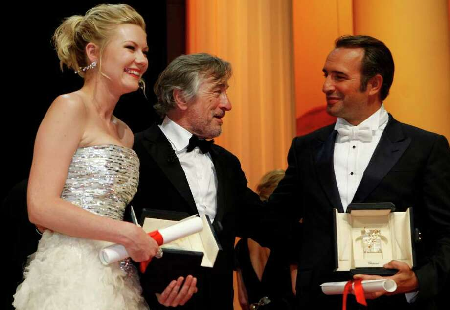 President of the jury Robert De Niro, center, talks with Best Actress recipient Kirsten Dunst, left, and Best Actor recipient Jean Dujardin, right, during the awards ceremony at the 64th international film festival, in Cannes, southern France, Sunday, May 22, 2011. (AP Photo/Lionel Cironneau) Photo: Lionel Cironneau