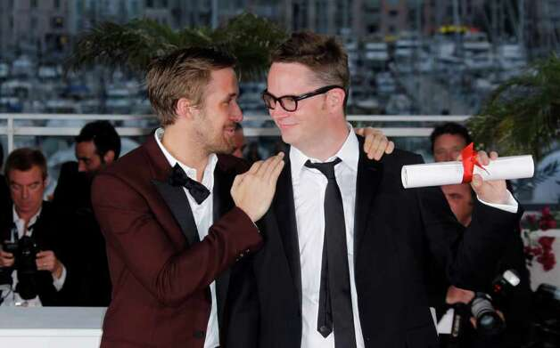 Director Nicolas Winding Refn, right, holds the award for Best Director for the film Drive, as he stands with actor Ryan Gosling, during the awards photo call at the 64th international film festival, in Cannes, southern France, Sunday, May 22, 2011. (AP Photo/Joel Ryan) Photo: Joel Ryan