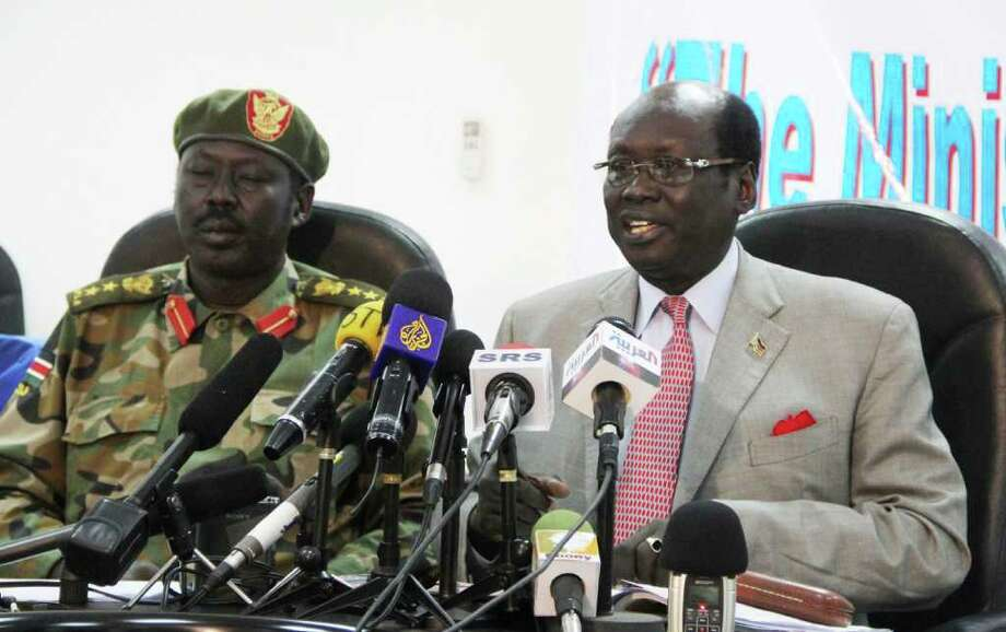 Southern army spokesman Colonel Philip Aguer, left, and information minister Barnaba Marial Benjamin, right, at a press conference  in Juba, Southern Sudan Sunday, May 22, 2011, where the Southern  government demanded that the northern Sudanese army immediately withdraw from the disputed border town of Abyei after they seized control late Saturday.   (AP Photo/ Maggie Fick) Photo: Maggie Fick / AP