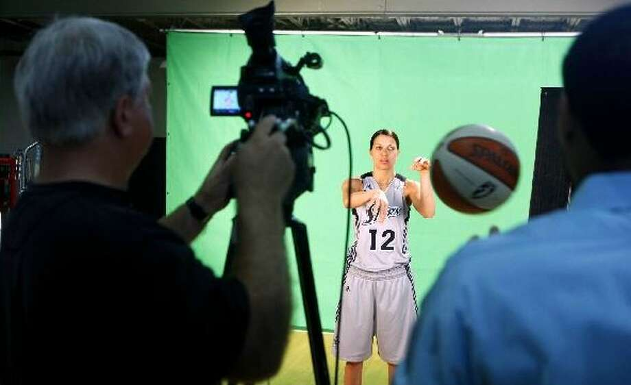 New Silver Stars guard Kelly Mazzante has her photo taken during the team's media day. WILLIAM LUTHER/wluther@express-news.net