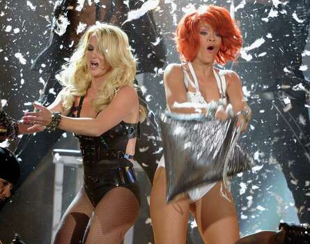 LAS VEGAS, NV - MAY 22:  Singers Britney Spears (L) and Rihanna perform onstage during the 2011 Billboard Music Awards at the MGM Grand Garden Arena May 22, 2011 in Las Vegas, Nevada.  (Photo by Ethan Miller/Getty Images for ABC) Photo: Ethan Miller, Getty Images For ABC / 2011 Getty Images
