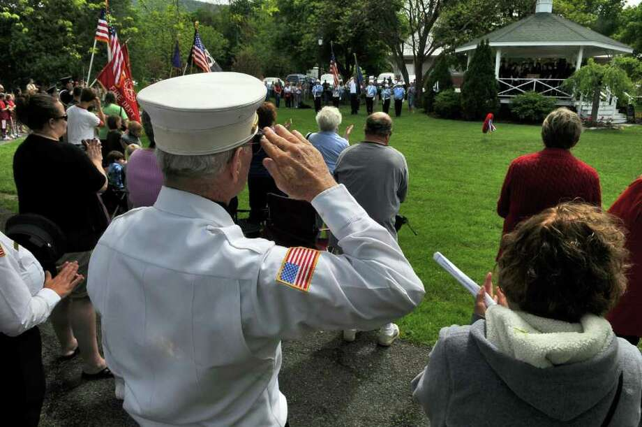 Jerry O' Malley, President and Past Chief of the East Berne Volunteer Fire Department, salutes the flag during the singing of the national anthem by the Berne Knox Westerlo High School chorus during Memorial Day ceremonies following the Altamont Memorial Day Parade on Sunday  May 22, 2011 in Altamont, NY. ( Philip Kamrass / Times Union) Photo: Philip Kamrass
