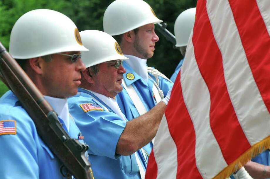 An honor guard from the Helderberg American Legion Post 977 of Altamont march just behind a police escort at the head of the Altamont Memorial Day Parade on Main Street on Sunday  May 22, 2011 in Altamont, NY. ( Philip Kamrass / Times Union) Photo: Philip Kamrass