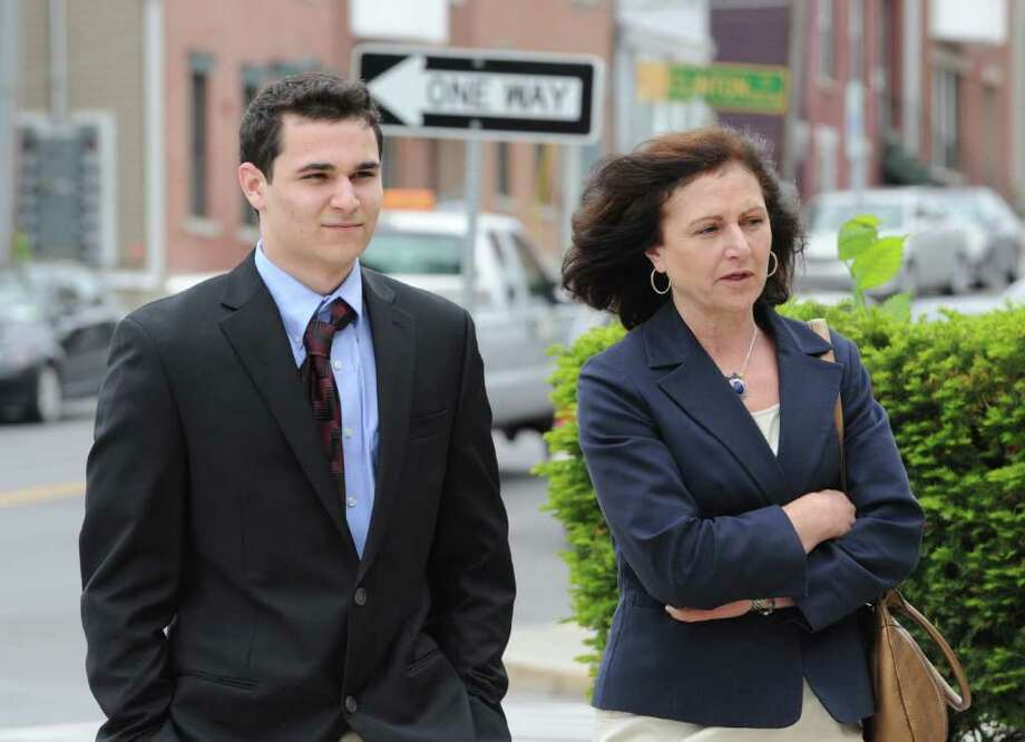 Evan Sapio,18, left accompanied by his mother enters Albany, N.Y. City Court May 23, 2011, for his appearance on charges he received in the Kegs and Eggs riot earlier this year.(Skip Dickstein / Times Union) Photo: SKIP DICKSTEIN / 2008