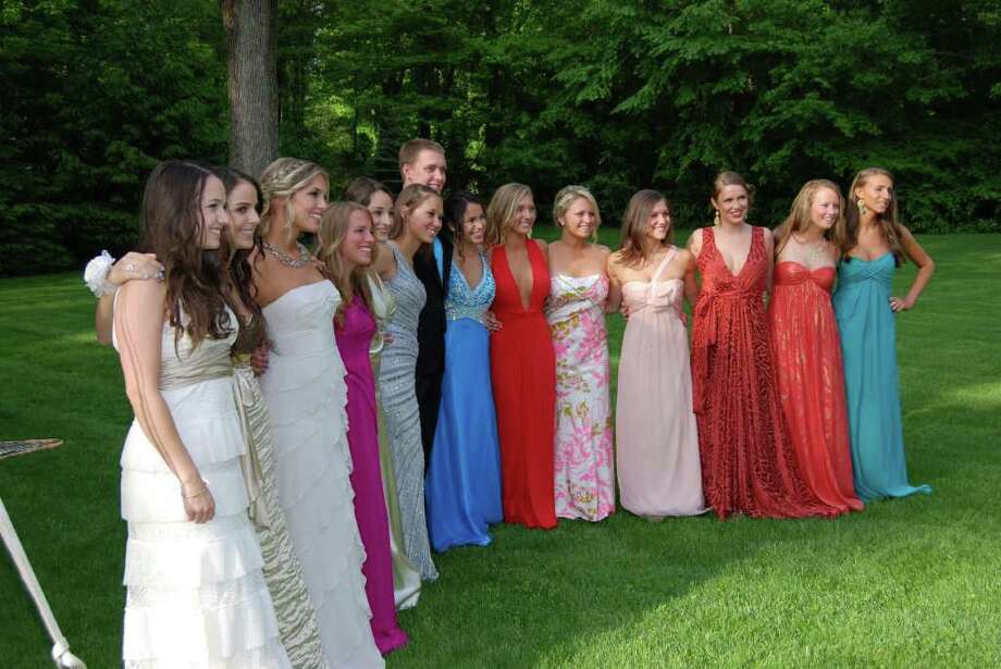 New Canaan High School Senior Prom godesses gather around Henry Lloyd  at a pre-prom party last Friday night, May 20, 2011. Photo: Jeanna Petersen Shepard / New Canaan News