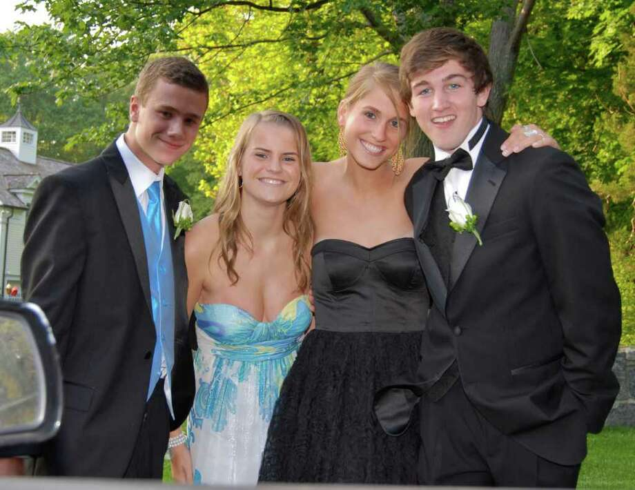 Connor Hedley, Austin Ready, Christina Loop, and Lucas Stopper head to their car to go to the prom at the Marriott Hotel in Stamford. Photo: Jeanna Petersen Shepard / New Canaan News