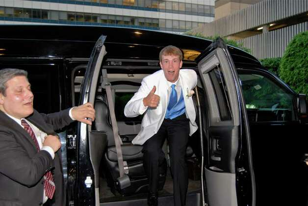 Tom Krieger hops out of the van rarin' to go! Photo: Jeanna Petersen Shepard / New Canaan News