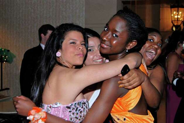 The girls have a group hug!  Carla Paredes, Laura Huertas, Taylor Joyner, and Jasmine Nelson at the NCHS Senior Prom. Photo: Jeanna Petersen Shepard / New Canaan News