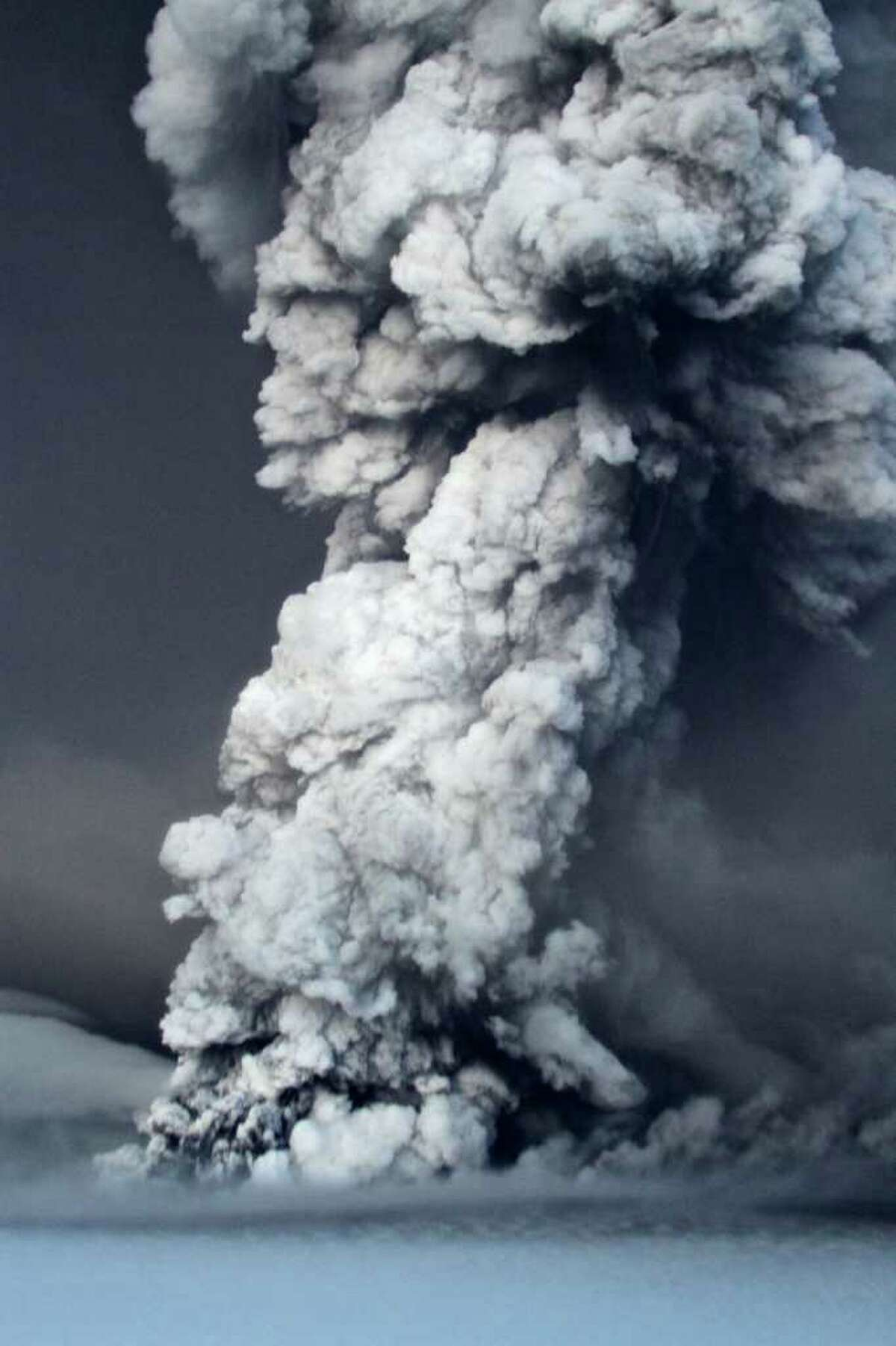 In this photo taken on Saturday, May 21, 2011, smoke plumes from the Grimsvotn volcano, which lies under the Vatnajokull glacier, about 120 miles, (200 kilometers) east of the capital, Rejkjavik, which began erupting Saturday for the first time since 2004. Iceland closed its main international airport and canceled domestic flights Sunday as a powerful volcanic eruption sent a plume of ash, smoke and steam 12 miles (20 kilometers) into the air. (AP Photo, Jon Gustafsson) ICELAND OUT