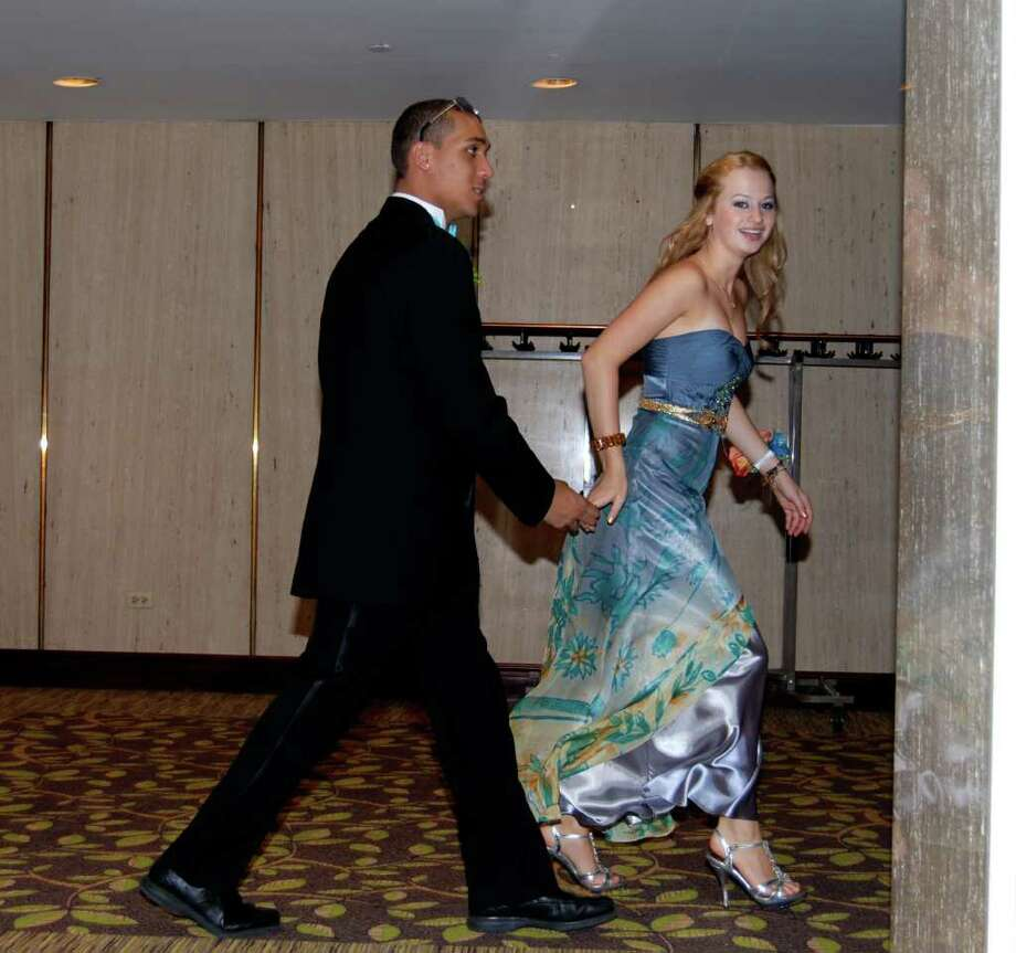 Deanna Kaplan leads Ryyan Taylor by the hand at the NCHS Senior Prom. Photo: Jeanna Petersen Shepard / New Canaan News