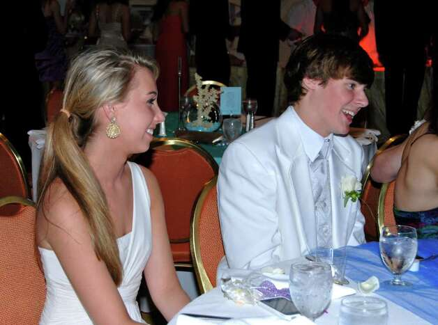 Emily King and James Burton have some laughs at their table. Photo: Jeanna Petersen Shepard / New Canaan News