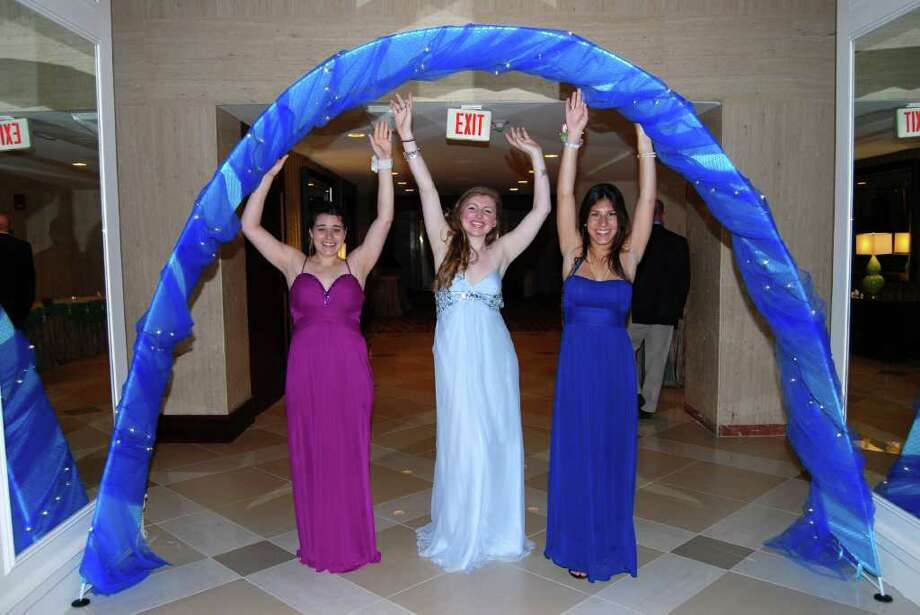Danielle Martin, Jasmine Allen, and Martina Berg under the decorated arch at the Stamford Marriott during NCHS prom. Photo: Jeanna Petersen Shepard / New Canaan News