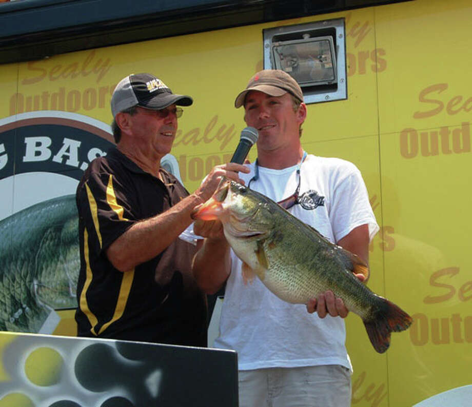 Clay Shipp of Columbia, LA caught this incredible 11.60 lb bass just in time to win the McDonald's Big Bass Splash.  Along with his hourly cash winnings, he also won a new Dodge truck & Triton boat! Photo: Patty Lenderman