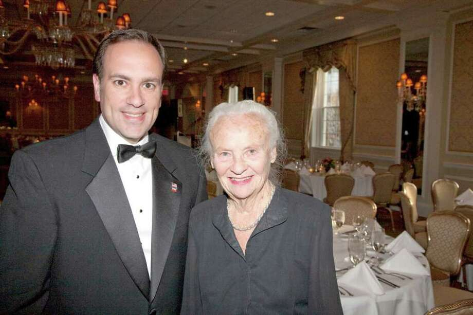 First Selectman Peter Tesei joins Mary Radcliffe, President of the Greenwich Symphony, at the GSO's recent gala benefiting the symphony and its Young People's Concert program. Photo: Contributed Photo / Greenwich Citizen