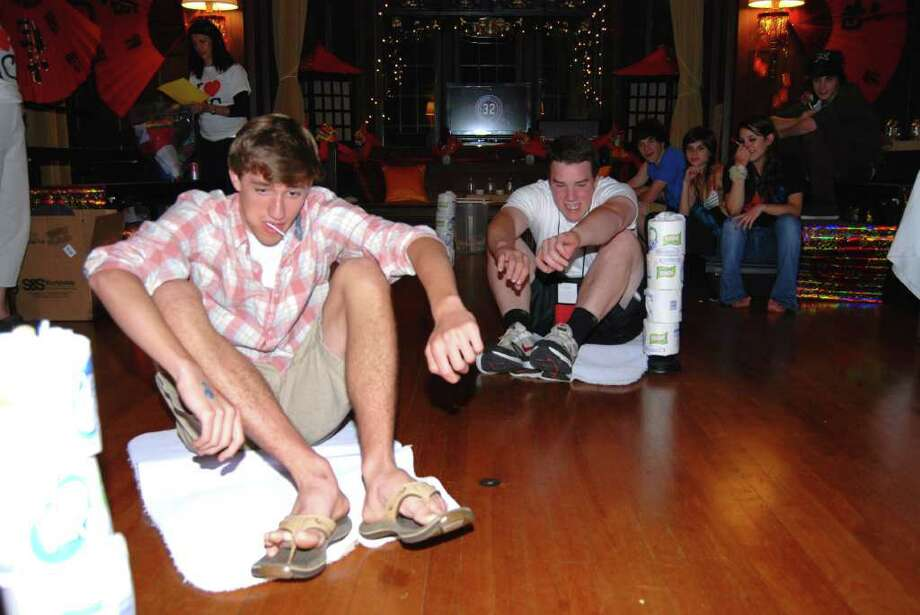 """Paul Templeton and Alex Farina have """"A Minute to Win It."""" Photo: Jeanna Petersen Shepard / New Canaan News"""