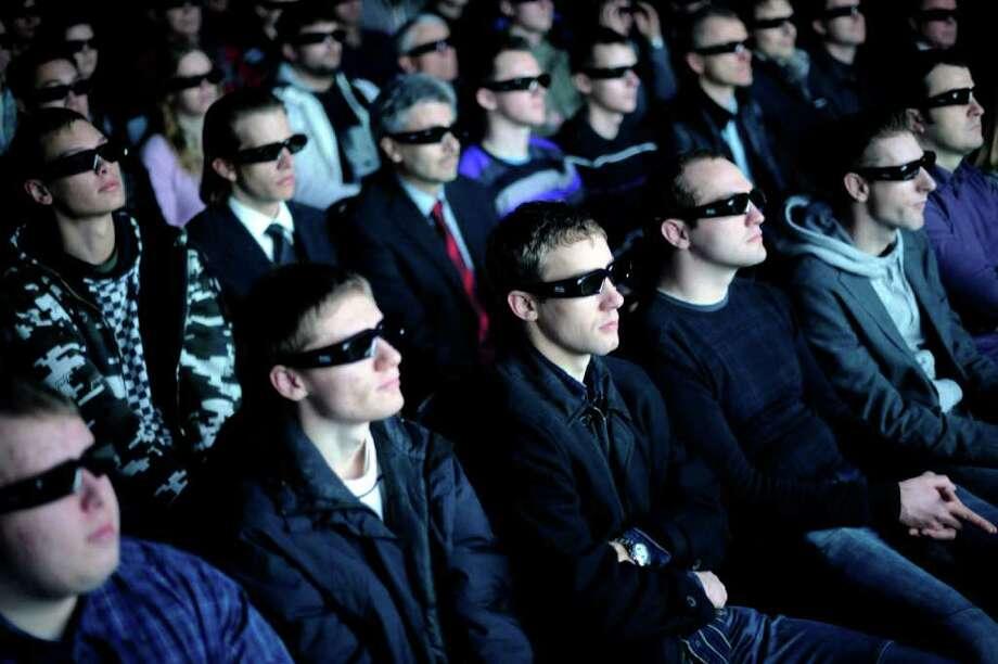 3D glasses? Or sunglasses? Photo: NIGEL TREBLIN, NIGEL TREBLIN/AFP/Getty Images / 2010 AFP
