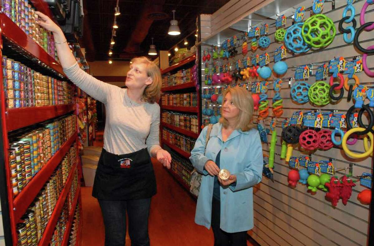 Salesperson Alison Patrick helps Betty Vondi find the right food for her cat at Global Pet Foods, a new holistic pet food store in Goodwives Shopping Center in Darien, Conn. on Monday May 23, 2011.