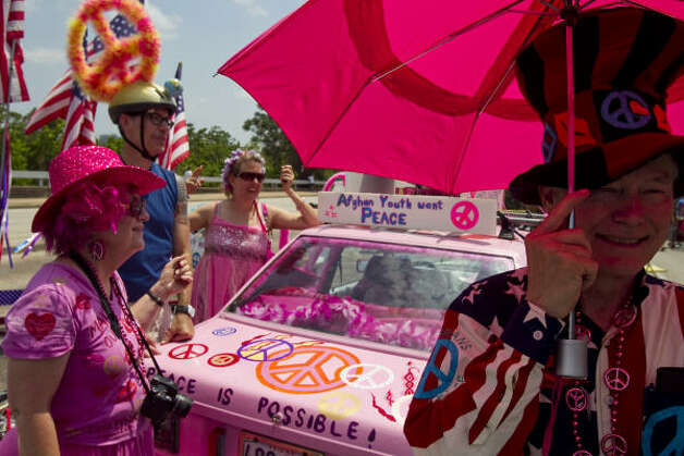 "Jim Williams, right, of Veterans for Peace, visits the anti-war art car ""Code Pink Peace Mobile."" Photo: Nick De La Torre/Chronicle"