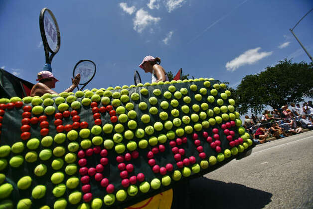 "Donne (left) and Tori Livingston ride in ""Better to Serve than Receive,"" a perfect car for any tennis enthusiast. Photo: Michael Paulsen/Houston Chronicl"