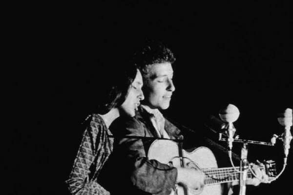 American folk singers Joan Baez and Bob Dylan perform together onstage, 1963.