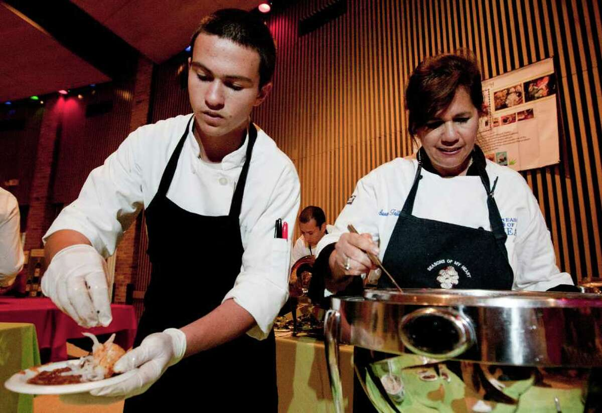 Kaelin Ulrich helps his mother Susana Trilling serve Best of Mexico guests at La Villita earlier this month. Ulrich is the youngest cook at Las Cananrias inside the Omni La Mansion.