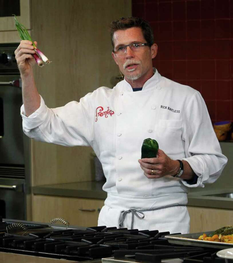 Celebrity chef Rick Bayless talks about red scallions, grown in his Chicago garden, that he's using in the ensalada Rusa during the Healthy Flavors, Healthy Kids summit. Photo: J. Michael Short