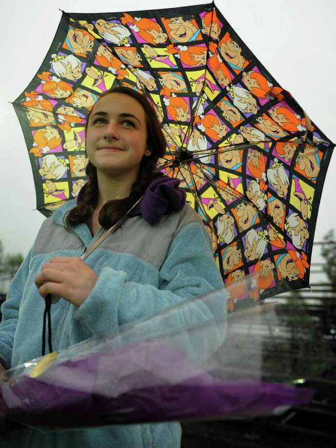 Emily Cox, 13 of Norwalk, watches her brother's lacrosse game from beneath a colorful Flintstones umbrella at Fairfield University's Alumni Field in Fairfield on Monday, May 23, 2011. Photo: Brian A. Pounds / Connecticut Post