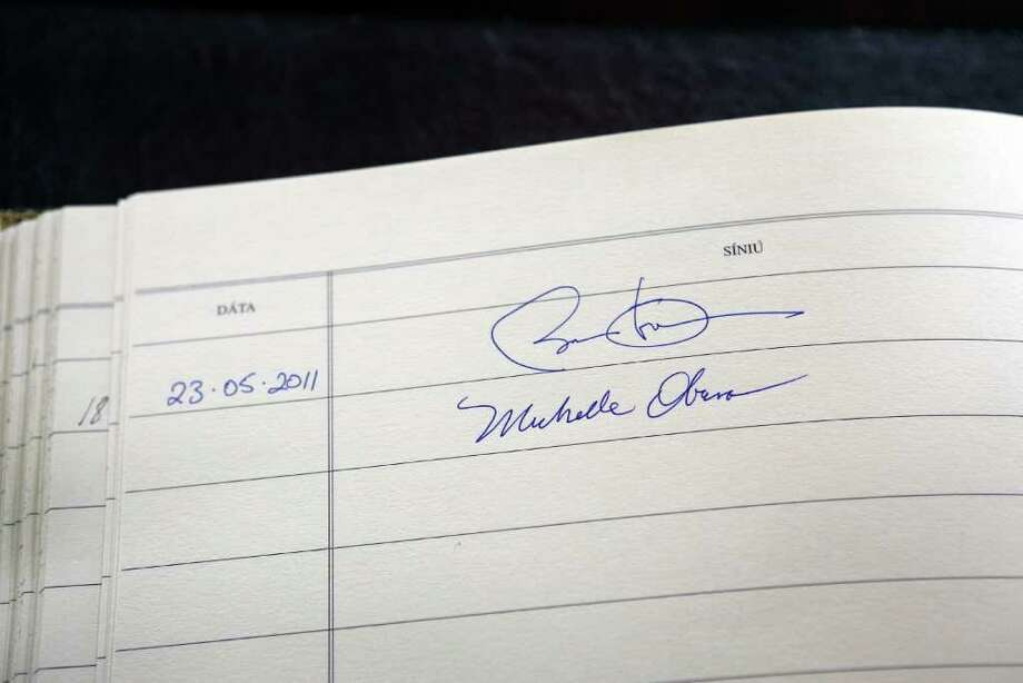 DUBLIN, IRELAND - MAY 23: The signatures of US President Barack Obama and First Lady Michelle Obama are seen in a visitors book at Aras an Uachtarain on May 23, 2011 in Dublin, Ireland. U.S. President Obama is visiting Ireland for one day. He will meet with distant relatives in Moneygall and speak at a rally in central Dublin after a concert.  (Photo by Peter Macdiarmid/Getty Images) Photo: Peter Macdiarmid, Getty Images / 2011 Getty Images
