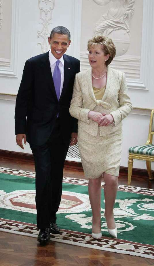 DUBLIN, IRELAND - MAY 23:  US President Barack Obama walks with President of Ireland Mary McAleese at Aras an Uachtarain on May 23, 2011 in Dublin, Ireland. U.S. President Obama is visiting Ireland for one day. He will meet with distant relatives in Moneygall and speak at a rally in central Dublin after a concert.  (Photo by Peter Macdiarmid/Getty Images) Photo: Peter Macdiarmid, Getty Images / 2011 Getty Images
