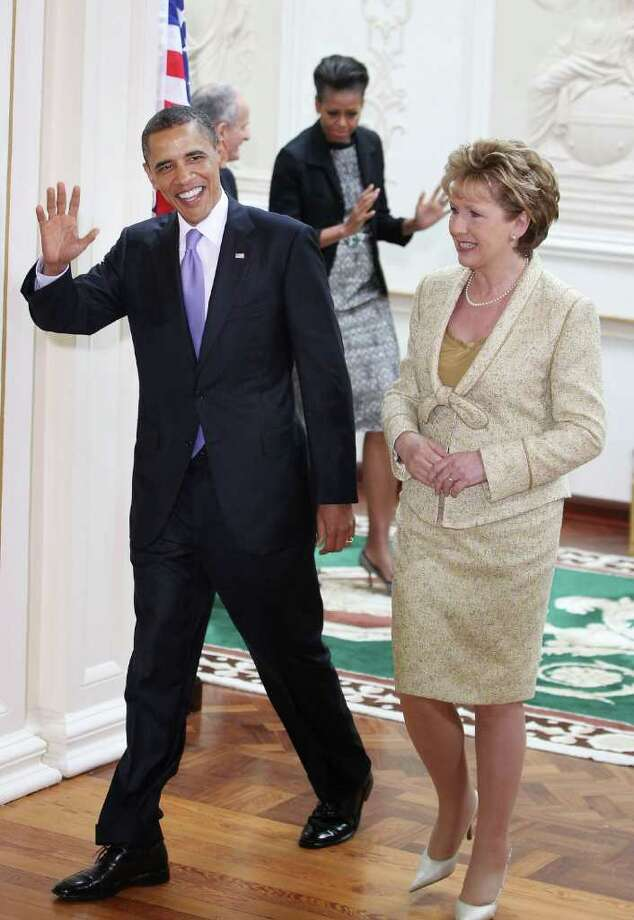 DUBLIN, IRELAND - MAY 23:  US President Barack Obama walks with President of Ireland Mary McAleese as Dr. Martin McAleese follows with First Lady Michelle Obama at Áras an Uachtaráin on May 23, 2011 in Dublin, Ireland. U.S. President Obama is visiting Ireland for one day. He will meet with distant relatives in Moneygall and speak at a rally in central Dublin after a concert.  (Photo by Peter Macdiarmid/Getty Images) Photo: Peter Macdiarmid, Getty Images / 2011 Getty Images