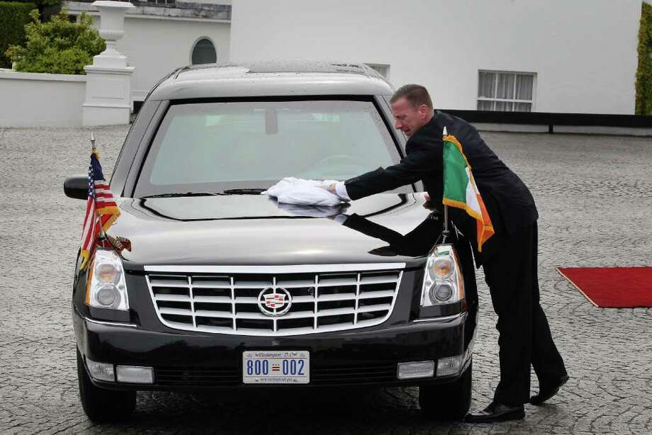 DUBLIN, IRELAND - MAY 23: A secret service agent wipes rainwater from US President Barack Obama's limousine at Áras an Uachtaráin on May 23, 2011 in Dublin, Ireland. U.S. President Obama is visiting Ireland for one day. He will meet with distant relatives in Moneygall and speak at a rally in central Dublin after a concert.  (Photo by Peter Macdiarmid/Getty Images) Photo: Peter Macdiarmid, Getty Images / 2011 Getty Images