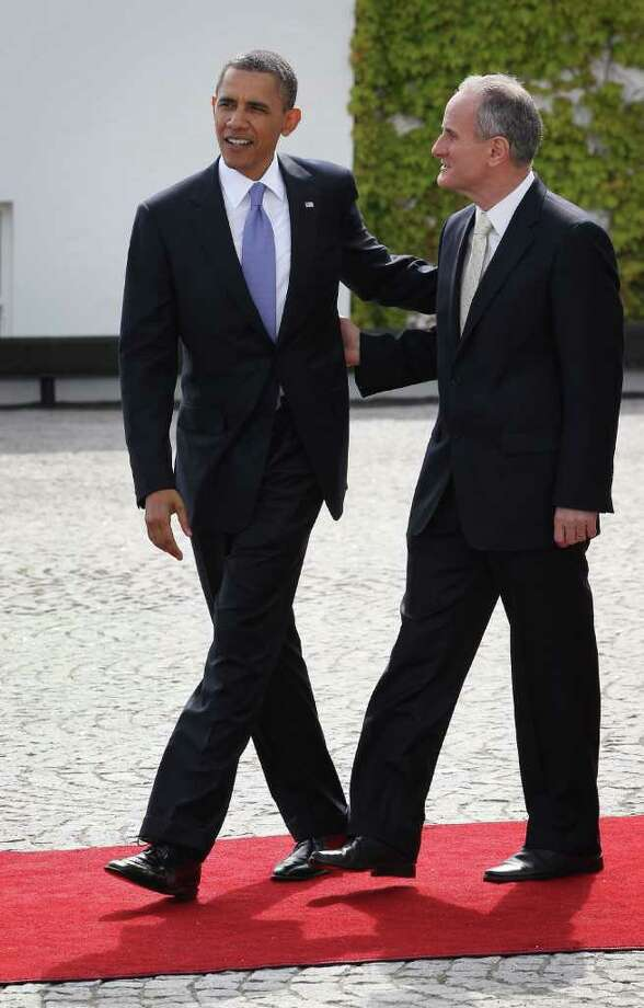 DUBLIN, IRELAND - MAY 23:  US President Barack Obama walks with Dr Martin McAleese husband of Irish President Mary McAleese at Áras an Uachtaráin on May 23, 2011 in Dublin, Ireland. U.S. President Obama is visiting Ireland for one day. He will meet with distant relatives in Moneygall and speak at a rally in central Dublin after a concert.  (Photo by Peter Macdiarmid/Getty Images) Photo: Peter Macdiarmid, Getty Images / 2011 Getty Images