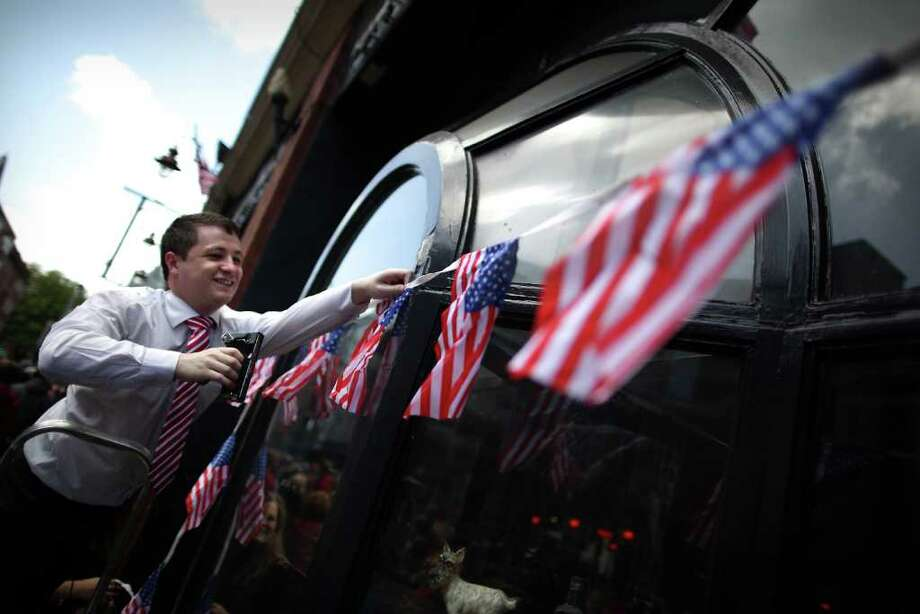 DUBLIN, IRELAND - MAY 23:  A man hangs Stars and Stripes bunting on May 23, 2001 in Dublin, Ireland. U.S. President Obama is visiting Ireland for one day. He will meet with distant relatives in Moneygall and speak at a rally in central Dublin after a concert.  (Photo by Peter Macdiarmid/Getty Images) Photo: Peter Macdiarmid, Getty Images / 2011 Getty Images