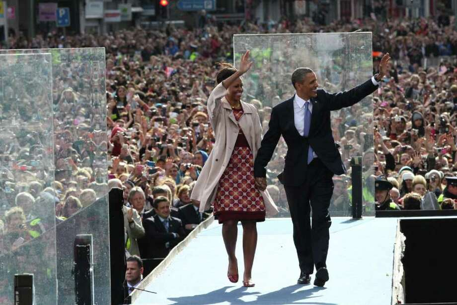 DUBLIN, IRELAND - MAY 23:  US President Barack Obama and First Lady Michelle Obama attend a rally on College Green on May 23, 2011 in Dublin, Ireland. US President Obama is visiting Ireland for one day. Earlier he met with Irish President Mary McAleese, Taoiseach (Prime Minister) of Ireland Enda Kenny and visited his ancestral home in Moneygall, County Offaly.  (Photo by Peter Macdiarmid/Getty Images) Photo: Peter Macdiarmid, Getty Images / 2011 Getty Images