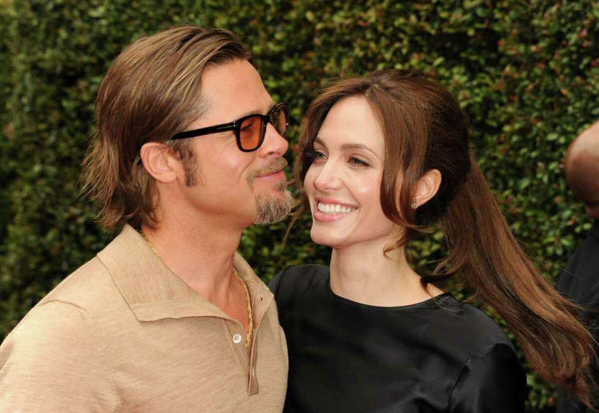"""Actors Brad Pitt (L) and Angelina Jolie arrive at the Los Angeles premiere Of DreamWorks Animation's """"Kung Fu Panda 2"""" held at Grauman's Chinese Theatre in Hollywood, California."""