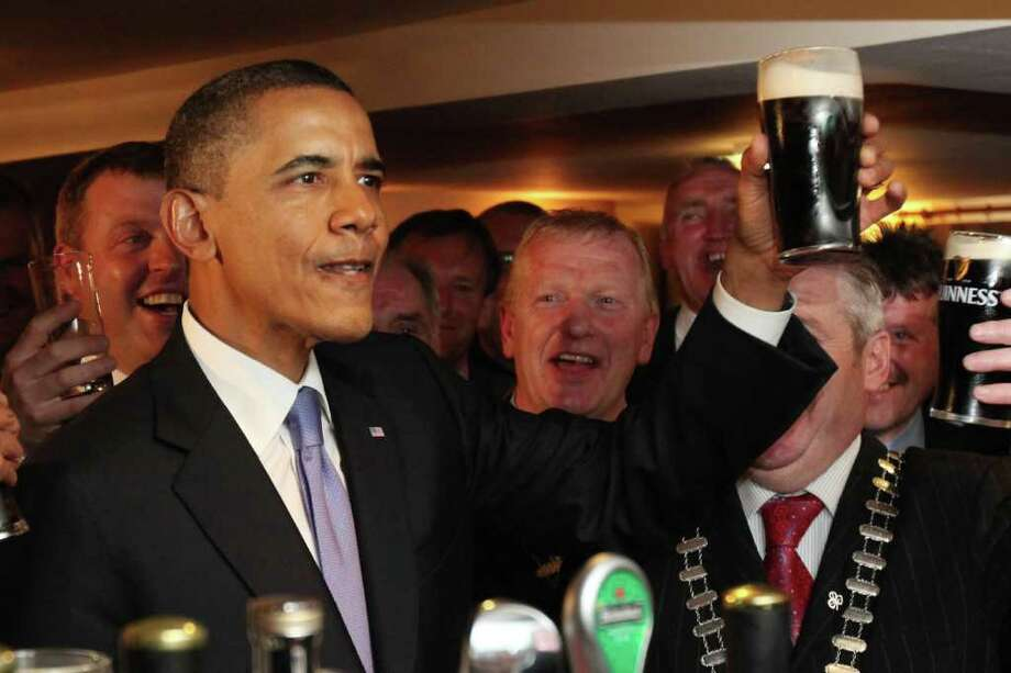 MONEYGALL, IRELAND - MAY 23: US President Barack Obama enjoys a glass of Guinness in his ancestral home of Moneygall, on May 23, 2001 in Moneygall, Ireland. U.S. President Obama is visiting Ireland for one day. He will meet with distant relatives in Moneygall and speak at a rally in central Dublin after a concert.   (Photo by Irish Government - Pool /Getty Images) Photo: Pool, Getty Images / 2011 Getty Images