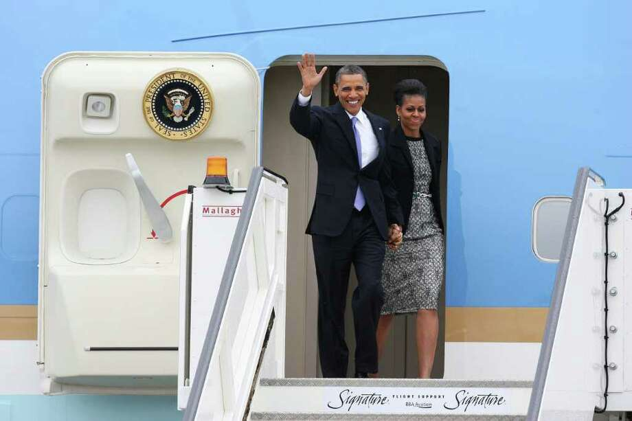 DUBLIN, IRELAND - MAY 23: US President Barack Obama and  First Lady Michelle Obama arrive at Dublin Airport for their visit to Ireland, on May 23, 2011 in Dublin, Ireland. U.S. President Obama is visiting Ireland for one day. He will meet with distant relatives in Moneygall and speak at a rally in central Dublin after a concert.   (Photo by Irish Government - Pool /Getty Images) Photo: Pool, Getty Images / 2011 Getty Images