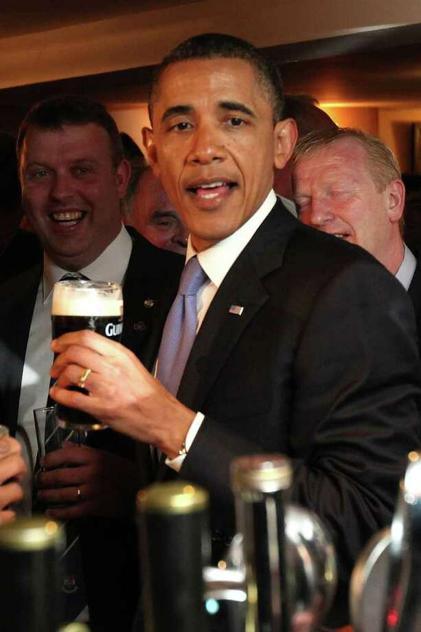 MONEYGALL, IRELAND - MAY 23:  US President Barack Obama enjoys a glass of Guinness in his ancestral home of Moneygall, on May 23, 2011 in Moneygall, Ireland. U.S. President Obama is visiting Ireland for one day at the start of a week long tour of Europe. He will meet with distant relatives in Moneygall and speak at a rally in central Dublin after a concert.   (Photo by Irish Government - Pool/Getty Images) Photo: Pool, Getty Images / 2011 Getty Images