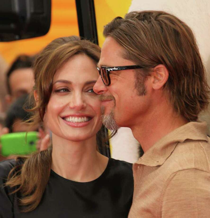 "Actress Angelina Jolie (L) and actor Brad Pitt attend the Premiere of DreamWorks Animation's ""Kung Fu Panda 2"" at Mann's Chinese Theatre in Hollywood, California. Photo: Frederick M. Brown, Getty Images / 2011 Getty Images"