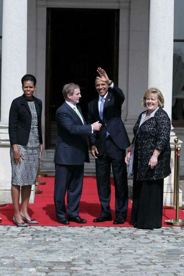 DUBLIN, IRELAND - MAY 23:  Irish Prime Minister Taoiseach Enda Kenny (2nd L) greets U.S. President Barack Obama (2nd R) as first lady Michelle Obama (L) and his wife Fionnuala Kenny look on at Farmleigh May 23, 2011 in Dublin, Ireland. U.S. President Obama is on a one-day visit to Ireland, where will meet with distant relatives in Moneygall and then speak at a rally in central Dublin after a concert.   (Photo by Irish Government-Pool /Getty Images) Photo: Pool, Getty Images / 2011 Getty Images