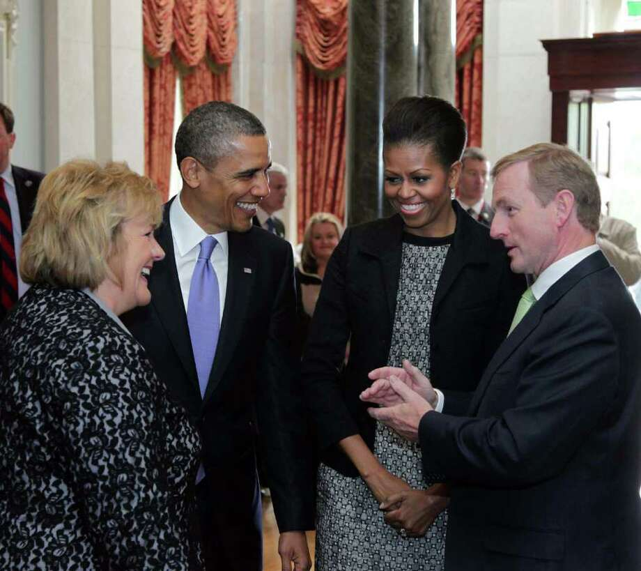 DUBLIN, IRELAND - MAY 23:  U.S. President Barack Obama (2nd L) and first lady Michelle Obama (2nd R) meet with Irish Prime Minister Taoiseach Enda Kenny (R) and his wife Fionnuala Kenny at Farmleigh May 23, 2011 in Dublin, Ireland. U.S. President Obama is on a one-day visit to Ireland, where will meet with distant relatives in Moneygall and then speak at a rally in central Dublin after a concert.   (Photo by Irish Government-Pool /Getty Images) Photo: Pool, Getty Images / 2011 Getty Images