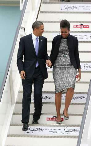 DUBLIN, IRELAND - MAY 23: U.S. President Barack Obama and first lady Michelle Obama arrive at the Dublin Airport May 23, 2011 in Dublin, Ireland.  Obama is visiting Ireland for one day. He will meet with distant relatives in Moneygall and speak at a rally in central Dublin after a concert.  (Photo by Irish Government - Pool /Getty Images) Photo: Pool, Getty Images / 2011 Getty Images