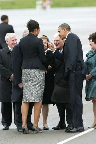 DUBLIN, IRELAND - MAY 23: U.S. President Barack Obama and first lady Michelle Obama speak with American Ambassador Dan Rooney upon their arrival at the Dublin Airport May 23, 2011 in Dublin, Ireland.  Obama is visiting Ireland for one day. He will meet with distant relatives in Moneygall and speak at a rally in central Dublin after a concert.  (Photo by Irish Government - Pool /Getty Images) Photo: Pool, Getty Images / 2011 Getty Images