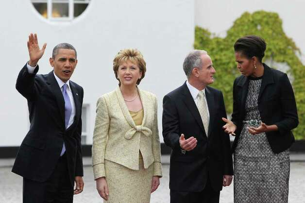 DUBLIN, IRELAND - MAY 23: (L - R) U.S. President Barack Obama, Irish President Mary McAleese, Dr. Martin McAleese and first lady Michelle Obama meet at Aras an Uachtarain, the official residence of the President of Ireland, May 23, 2011 in Dublin, Ireland.  Obama is visiting Ireland for one day. He will meet with distant relatives in Moneygall and speak at a rally in central Dublin after a concert.  (Photo by Irish Government - Pool /Getty Images) Photo: Pool, Getty Images / 2011 Getty Images