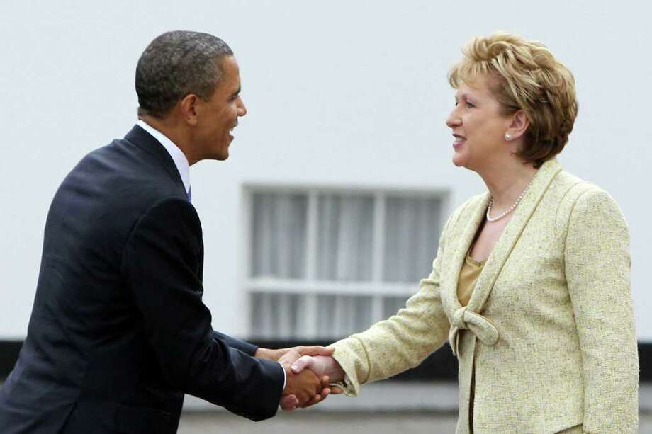 DUBLIN, IRELAND - MAY 23: U.S. President Barack Obama and Irish President Mary McAleese shake hands at Aras an Uachtarain, the official residence of the President of Ireland, May 23, 2011 in Dublin, Ireland.  Obama is visiting Ireland for one day. He will meet with distant relatives in Moneygall and speak at a rally in central Dublin after a concert.  (Photo by Irish Government - Pool /Getty Images) Photo: Pool, Getty Images / 2011 Getty Images